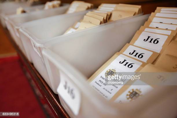 Envelopes containing a randomized selection of coins sit in boxes ready to be sorted counted and weighed before the opening of the Trial of the Pyx...