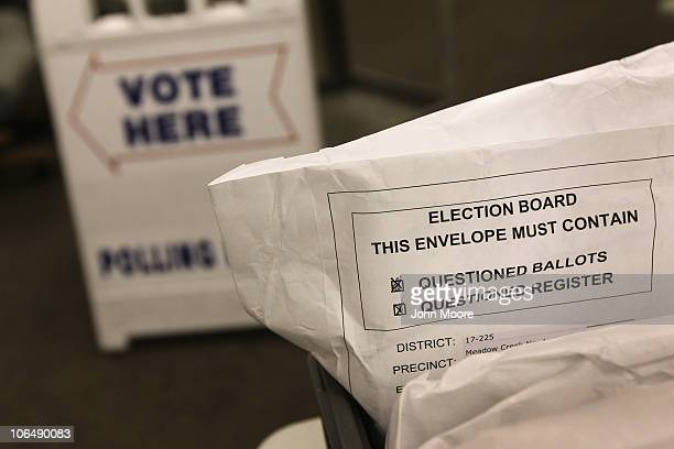 Envelopes of completed questioned ballots also known as provisional ballots await inspection at the Alaska state elections office on November 3 2010...