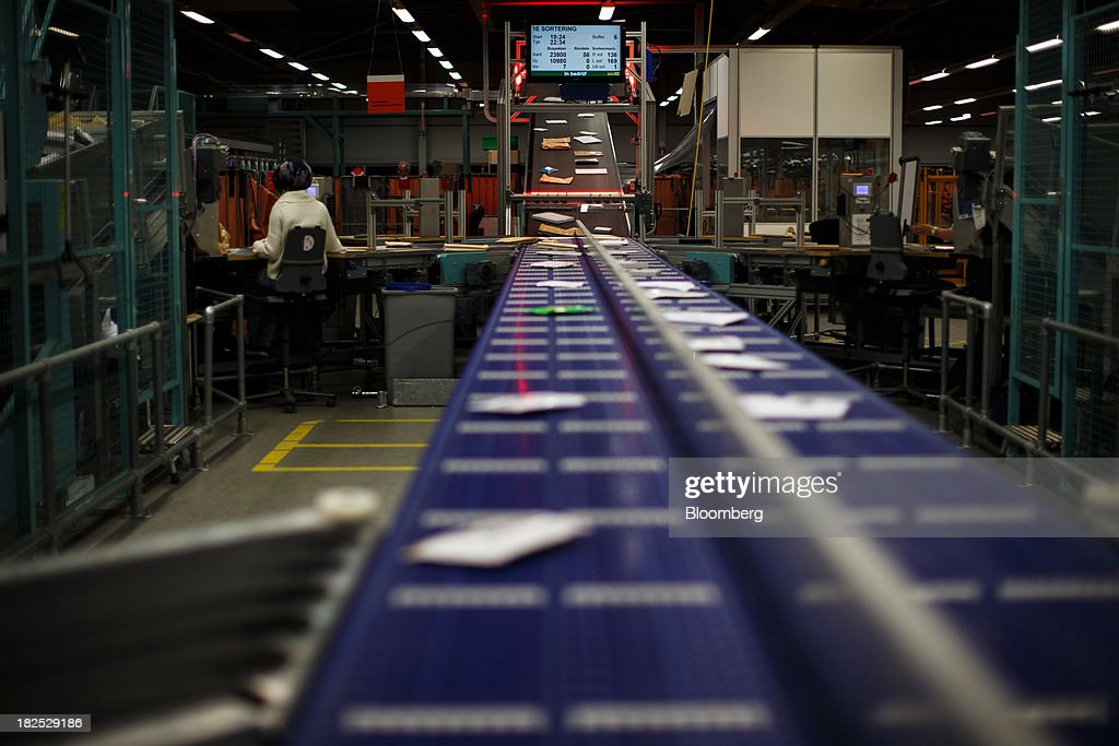 Envelopes pass along a conveyor belt at the PostNL NV mail sorting center in Nieuwegein, Netherlands, on Friday, Sept. 27, 2013. PostNL NV rose the most in two months on Sept. 19 after the Dutch postal operator raised its full-year forecast and announced higher prices for stamps. Photographer: Jasper Juinen/Bloomberg via Getty Images