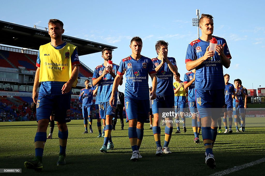Enver Alivodic (C) Nigel Boogaard (R) of the Jets celebrate the win with his team mates during the round 18 A-League match between the Newcastle Jets and Melbourne City FC at Hunter Stadium on February 7, 2016 in Newcastle, Australia.