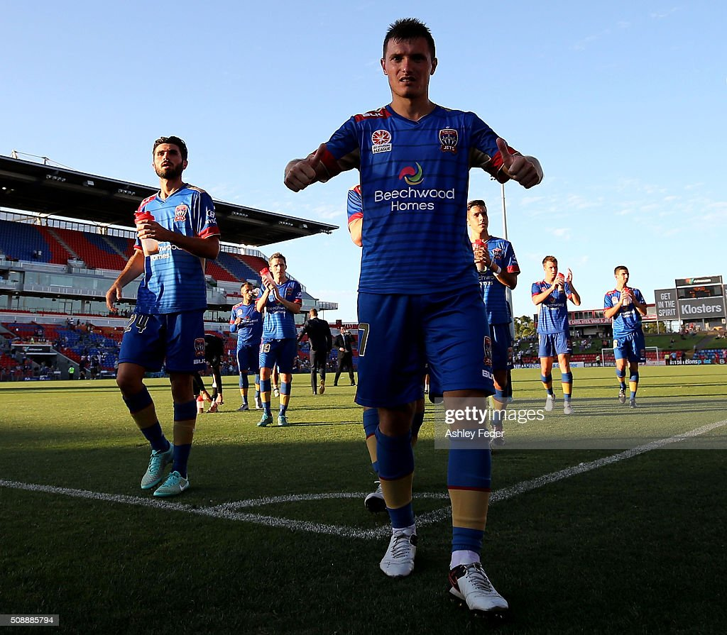 Enver Alivodic of the Jets celebrates the win with his team mates during the round 18 A-League match between the Newcastle Jets and Melbourne City FC at Hunter Stadium on February 7, 2016 in Newcastle, Australia.