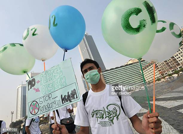 Environment activists hold balloons with Oxygen sign during an environmental campaign in Jakarta on June 5 2008 to mark the World Environment Day...