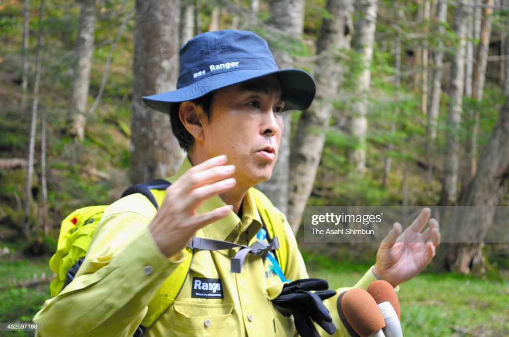 Environment Minister <a gi-track='captionPersonalityLinkClicked' href=/galleries/search?phrase=Nobuteru+Ishihara&family=editorial&specificpeople=2258645 ng-click='$event.stopPropagation()'>Nobuteru Ishihara</a> speaks to the media reporters after inspecting the damage of Shika deer feeding on July 23, 2014 in Minami-Alps, Yamanashi, Japan. The forest damage by shika deers have been serious recent years.