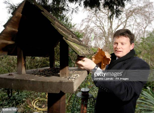 Environment Minister Richard Benyon hangs a places bird seed on a bird table at a photocall in St James's Park London to launch the RSPB Big Garden...