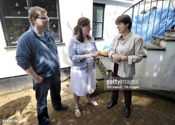 Environment secretary Caroline Spelman meets local residents Philip Nolwenn and Luke Nolwenn after flooding in Ottery St Mary Devon
