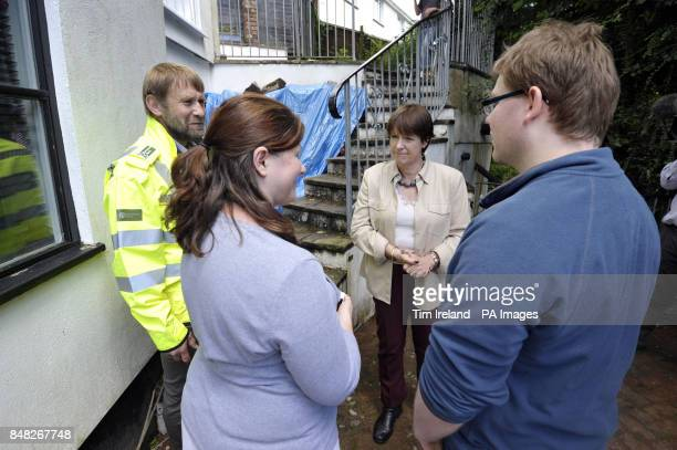 Environment secretary Caroline Spelman meets local residents Philip Nolwenn and Luke Nolwenn with Richard Cresswell Environment Agency director for...