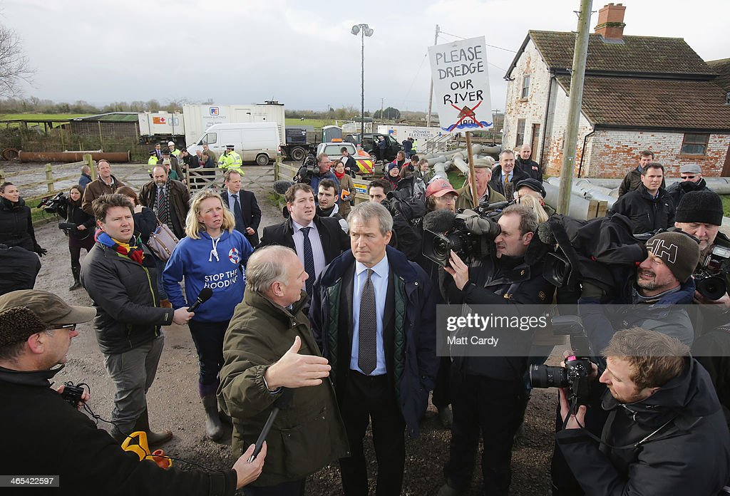 Environment Secretary Owen Paterson speaks with people as he visits the Northmoor Pumping Station in Moorland on January 27 2014 near Bridgwater...