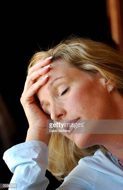 Environmental activist Erin Brockovich pauses to reflect as she explains that her case concerning cancer victims from Beverly Hills High School is...