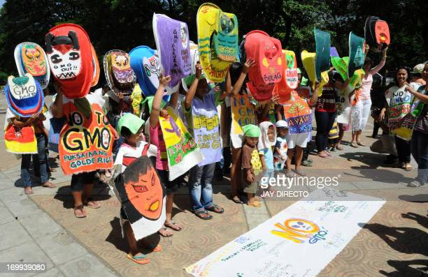 Environmental activist group Greenpeace and members of the 'Green Moms' gather for a rally in Manila on June 5 2013 to mark World Environment Day...