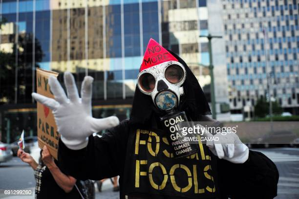 TOPSHOT Environmental activists and supporters take part in a demonstration in New York on June 1 to protest US President Donald Trump's decision to...