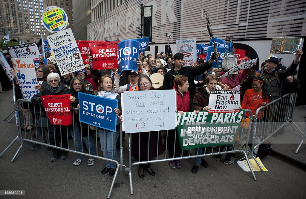 Environmental activists gather near the Waldorf Astria Hotel protesting the proposed Keystone XL pipeline, May 13, 2013 in New York. The group marched from Bryant Park through midtown to rally outside the Waldorf Astoria hotel where President Obama was attending a fundraiser. AFP PHOTO/Don Emmert