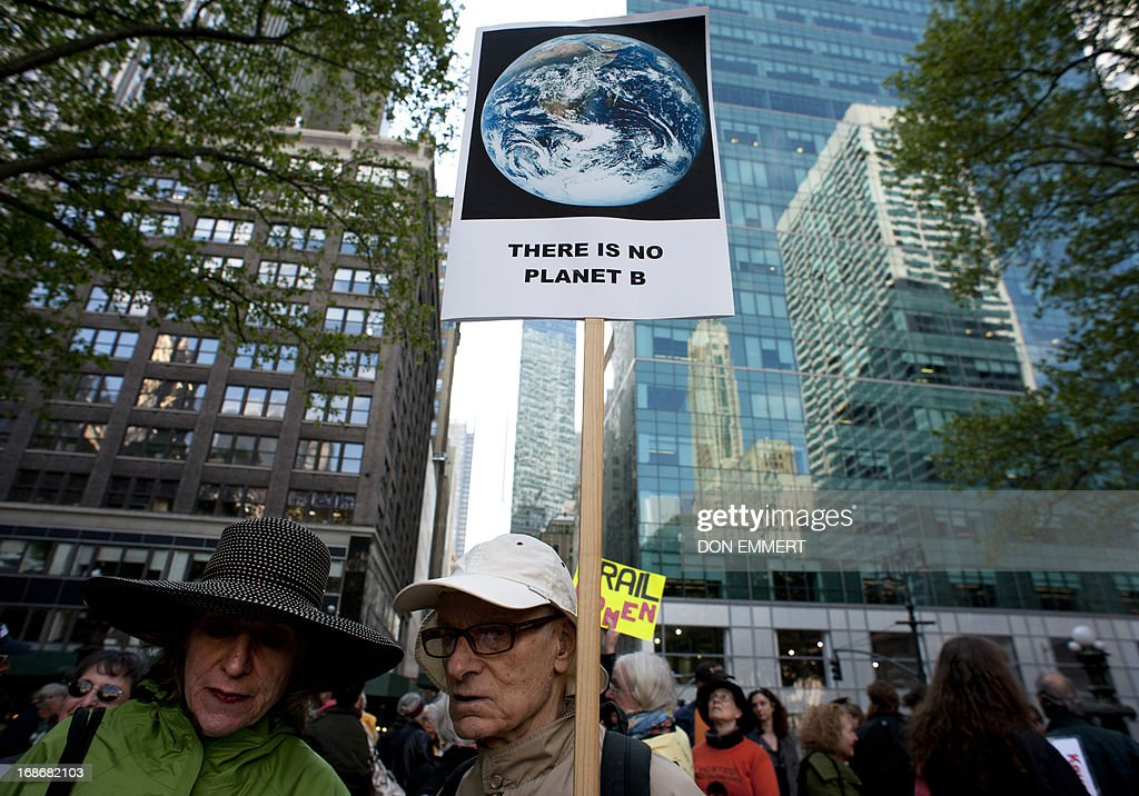 Environmental activists hold a gather in Bryant Park, protesting the proposed Keystone XL pipeline, May 13, 2013 in New York. The group marched through midtown to rally outside the Waldorf Astoria hotel where President Obama was attending a fundraiser. AFP PHOTO/Don Emmert