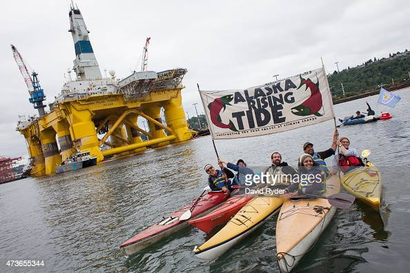 Environmental activists hold a sign during ShellNo flotilla demonstrations against Royal Dutch Shell near the Polar Pioneer oil drilling rig on May...