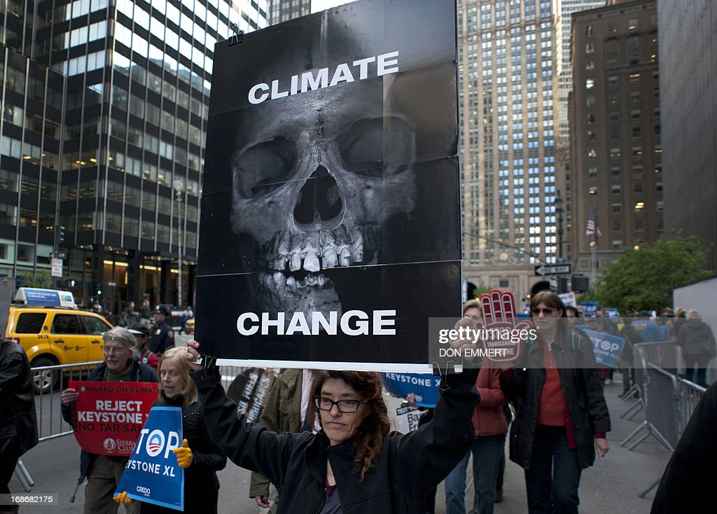 Environmental activists march through midtown protesting the proposed Keystone XL pipeline, May 13, 2013 in New York. The group marched from Bryant Park through midtown to rally outside the Waldorf Astoria hotel where President Obama was attending a fundraiser. AFP PHOTO/Don Emmert