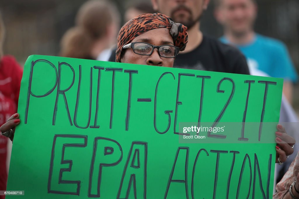 Environmental activists protest outside the Carrie Gosch Elementary School before a visit by U.S. EPA Adminstrator Scott Pruitt on April 19, 2017 in East Chicago, Indiana. The school was closed after high levels of lead and arsenic were found in the West Calumet housing complex which borders the school. The area has been declared an EPA superfund site. This was Pruitt's first visit to a superfund site since being named the agency's administrator.