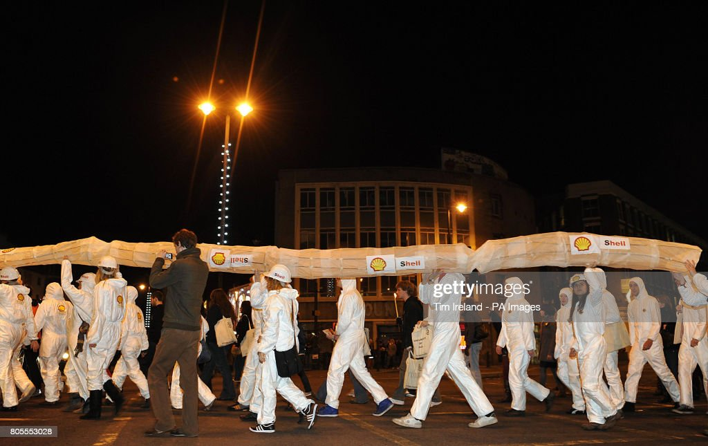 Environmental campaigners organised by Amnesty International carry a tube through Hoxton to protest against the activities of oil giant Shell in the Niger Delta.