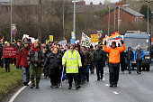 Environmental campaigners take part in a protest march near to the IGas Barton Moss fracking exploration rig on January 26 2014 in Salford England...
