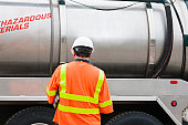 Environmental engineer with tank truck at hazardous waste cleanup site