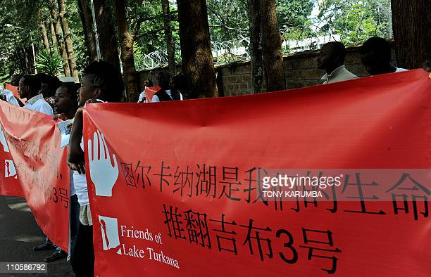 Environmental group 'Friends of Lake Turkana' [FOLT] protest outside the Chinese embassy in Nairobi February 20 2011 against the involvement of...