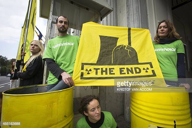 Environmental group Greenpeace activists hold a banner on September 10 as they take part in an action held by Greenpeace during government...