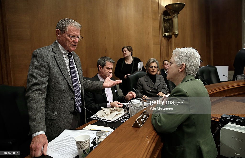 Environmental Protection Agency Administrator Gina McCarthy (R) confers with Sen. James Inhofe (R-OK) (L) before the start of a hearing January 16, 2014 in Washington, DC. McCarthy testified before the committee on the topic of a 'Review of the President's Climate Action Plan.'