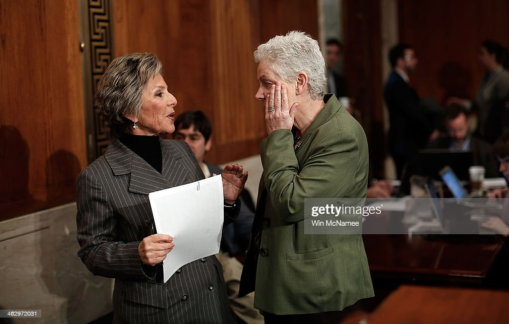 Environmental Protection Agency Administrator Gina McCarthy (R) confers with Senate Environment Committee Chairman Sen. <a gi-track='captionPersonalityLinkClicked' href=/galleries/search?phrase=Barbara+Boxer&family=editorial&specificpeople=169888 ng-click='$event.stopPropagation()'>Barbara Boxer</a> (D-CA) (L) before the start of a hearing January 16, 2014 in Washington, DC. McCarthy testified before the committee on the topic of a 'Review of the President's Climate Action Plan.'