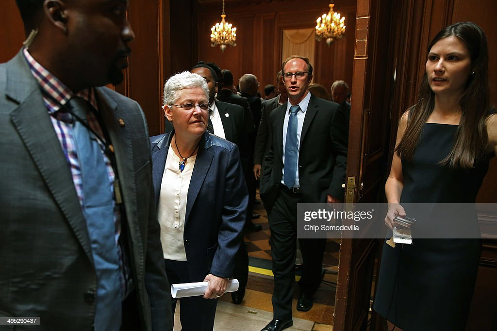 U.S. Environmental Protection Agency Administrator <a gi-track='captionPersonalityLinkClicked' href=/galleries/search?phrase=Gina+McCarthy&family=editorial&specificpeople=7904226 ng-click='$event.stopPropagation()'>Gina McCarthy</a> (2nd L) leaves after announcing new regulations for power plants at EPA headquarters June 2, 2014 in Washington, DC. Bypassing Congress and using President Barack Obama's 'Climate Action Plan,' the new regulations will force more than 600 existing coal-fired power plants, the single largest source of greenhouse gas emission in the country, to reduce their carbon pollution 30 percent from 2005 levels by 2030.