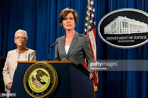 Environmental Protection Agency Administrator Gina McCarthy looks on as Deputy Attorney General Sally Q Yates speaks during a press conference at the...
