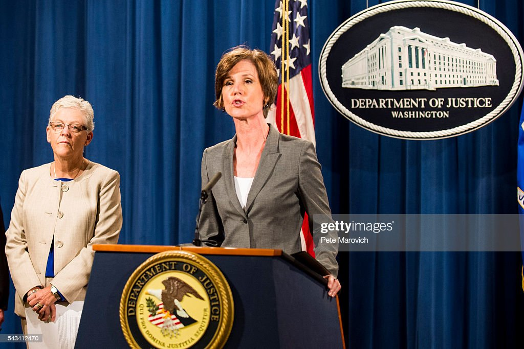 Environmental Protection Agency Administrator Gina McCarthy looks on as Deputy Attorney General Sally Q. Yates speaks during a press conference at the Department of Justice on June 28, 2016 in Washington, DC. Volkswagen has agreed to nearly $15 billion in a settlement over emissions cheating on its diesel vehicles.