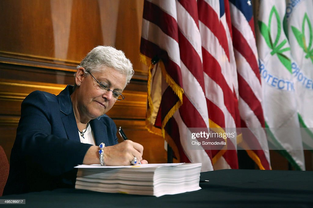 U.S. Environmental Protection Agency Administrator <a gi-track='captionPersonalityLinkClicked' href=/galleries/search?phrase=Gina+McCarthy&family=editorial&specificpeople=7904226 ng-click='$event.stopPropagation()'>Gina McCarthy</a> signs new regulations for power plants June 2, 2014 in Washington, DC. Bypassing Congress and using President Barack Obama's 'Climate Action Plan,' the new regulations will force more than 600 existing coal-fired power plants, the single largest source of greenhouse gas emission in the country, to reduce their carbon pollution 30 percent from 2005 levels by 2030.
