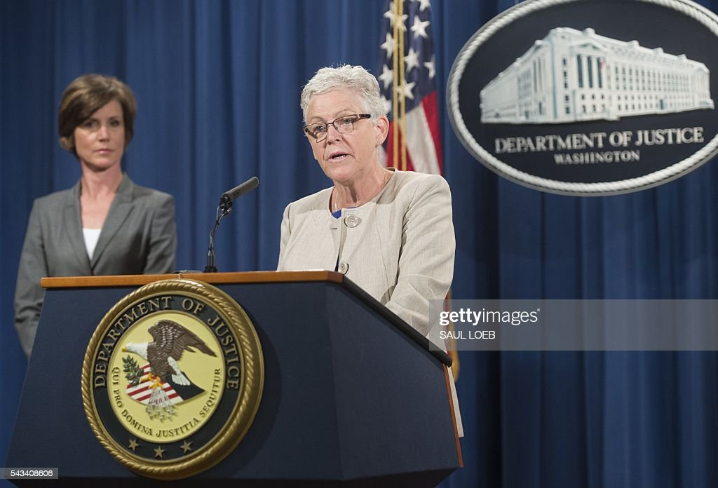 Environmental Protection Agency (EPA) Administrator Gina McCarthy speaks alongside Deputy Attorney General Sally Yates (L) during a press conference to announce environmental and consumer relief in the Volkswagen litigation at the Department of Justice in Washington, DC, June 28, 2016. Volkswagen has agreed to pay out $14.7 billion in a settlement with US authorities and car owners over its emissions-cheating diesel-powered cars, court documents showed June 28, 2016. The settlement filed in federal court calls for the German auto giant to either buy back or fix the cars that tricked pollution tests, and to pay each owner up to $10,000 in cash. LOEB