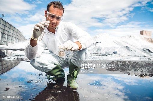 Environmental Scientist Examing Water