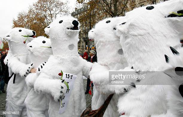 Environmentalist dressed in bear costumes demonstrate during the World Climate Change Conference 2015 on December 12 2015 in Paris France The first...