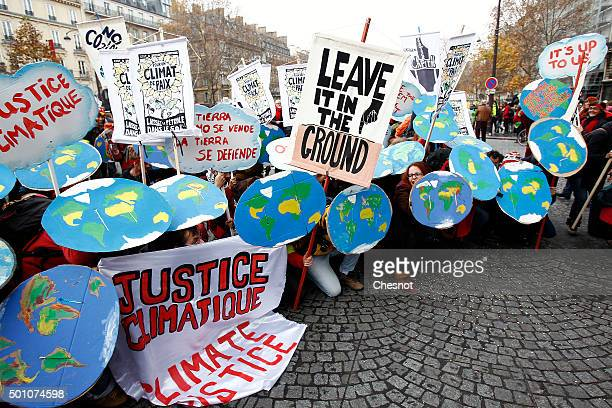Environmentalists demonstrate during the World Climate Change Conference 2015 on December 12 2015 in Paris France The first universal agreement on...