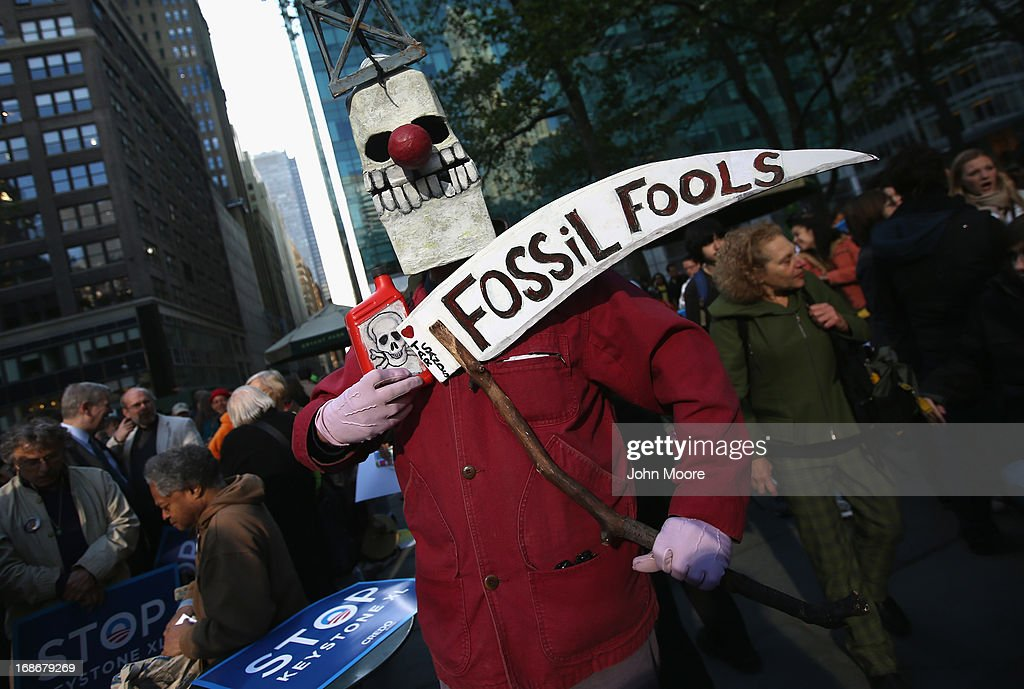 Environmentalists stage a protest to coincide with a fundraising event by President Barack Obama on May 13, 2013 in New York City. Hundreds of demonstrators marched to protest the building of oil pipelines and calling for the end of hydraulic fracking for oil and gas.