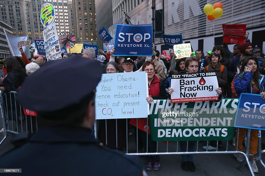 Environmentalists stage a protest to coincide with a fundraising event by U.S. President Barack Obama on May 13, 2013 in New York City. Hundreds of demonstrators marched to protest the building of oil pipelines and calling for the end of hydraulic fracking.