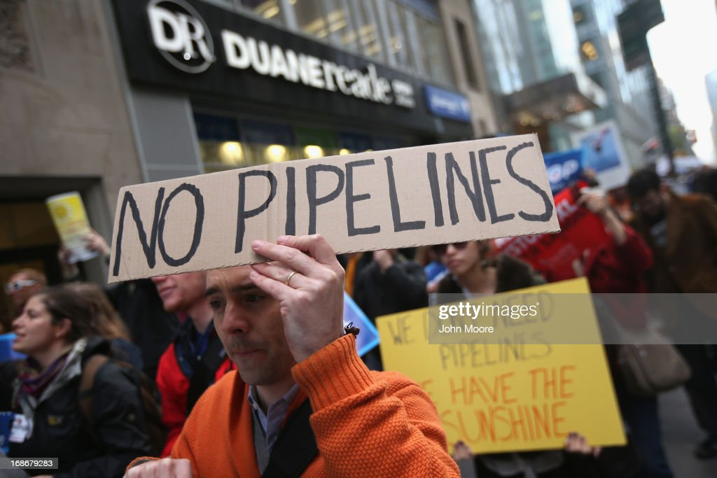 Environmentalists stage a protest to coincide with a fundraising event by U.S. President Barack Obama on May 13, 2013 in New York City. Hundreds of demonstrators marched to protest the building of oil pipelines and calling for the end of hydraulic fracking for oil and gas.