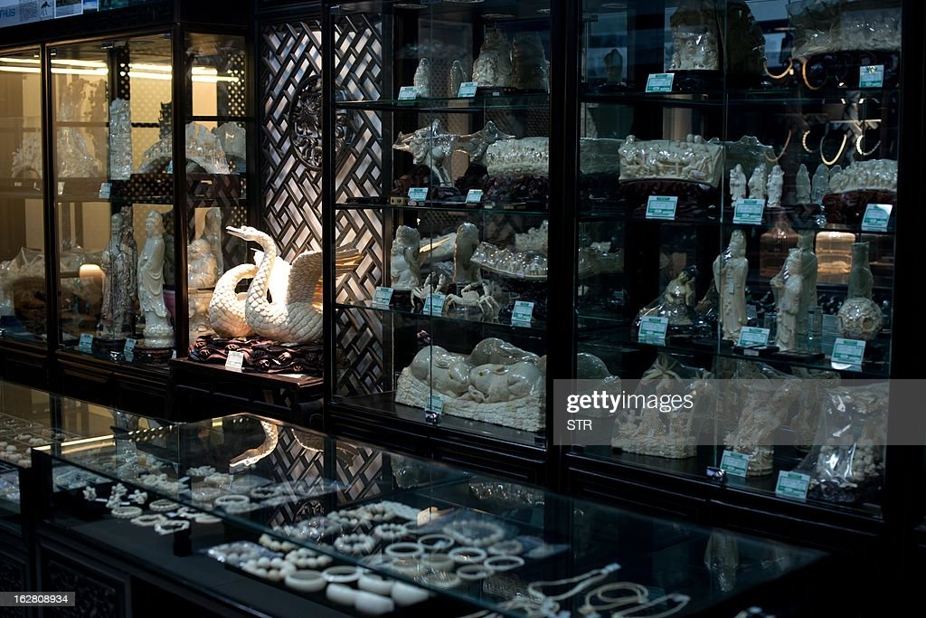 Environment-wildlife-CITES-ivory-China,FOCUS by Tom Hancock This photo taken on February 27, 2013 shows ivory bracelets on display at a shop in an antiques market in Beijing. Surging demand for ivory and rhino horn in Asia is behind an ever-mounting death toll of African elephants and rhinos, conservationists say, as authorities fail to rein in hugely lucrative international smuggling networks. AFP PHOTO