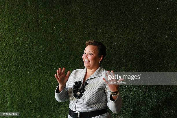 Environmetal Protection Agency Administrator Lisa Jackson stops in front of a wall covered with fake grass as she tours the Method home care company...