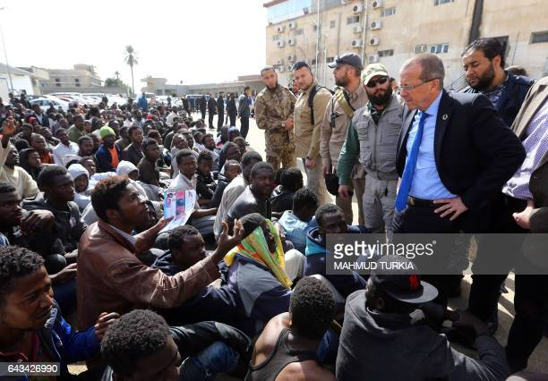 TOPSHOT UN envoy to Libya Martin Kobler talks to illegal migrants during a visit at a detention centre in the Libyan capital tripoli on February 21...