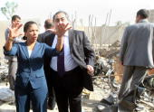 US envoy to the United Nations Susan Rice gestures as she stands with Iraqi Foreign Minister Hoshyar Zebari on October 24 looking at the destroyed...