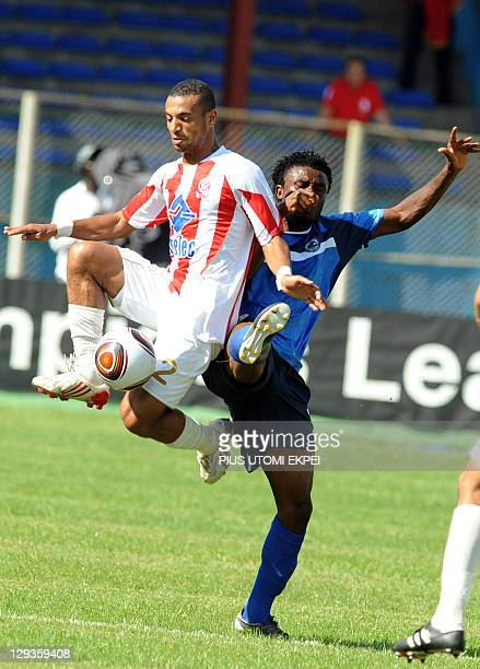Enyimba's attacker Josiah Maduabuchi struggles for possession with Ayoub Skouma of Wydad Casablanca during the African Championships League second...