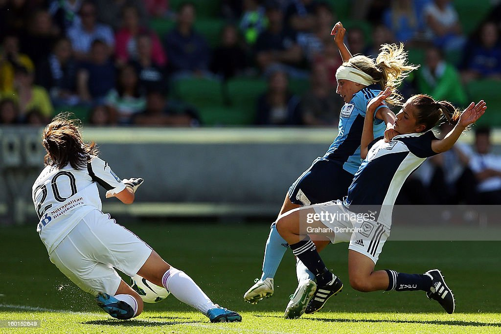 Enza Barilla of the Victory (R) slides in on goal under pressure from Annalie Longo (C) and Sham Khamis of Sydney FC during the W-League Grand Final between the Melbourne Victory and Sydney FC at AAMI Park on January 27, 2013 in Melbourne, Australia.