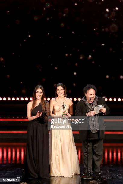 Enzo Avitabile receives the Best Original Song Award with Marianna Fontana and Angela Fontana during the 61 David Di Donatello ceremony on March 27...