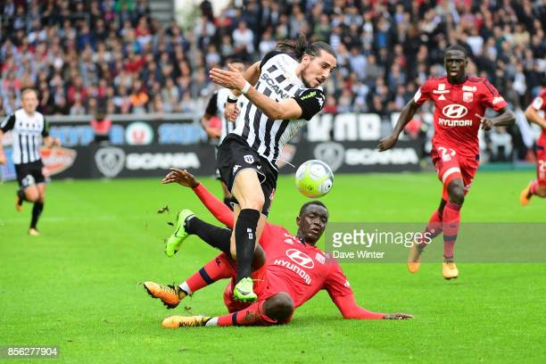 Enzo Crivelli of Angers and Ferland Mendy of Lyonduring the Ligue 1 match between Angers SCO and Olympique Lyonnais at Stade Raymond Kopa on October...