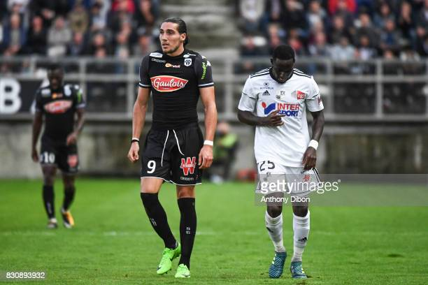 Enzo Crivelli of Angers and Issa Cissokho of Amiens during the Ligue 1 match between Amiens SC and Angers SCO at Stade de la Licorne on August 12...