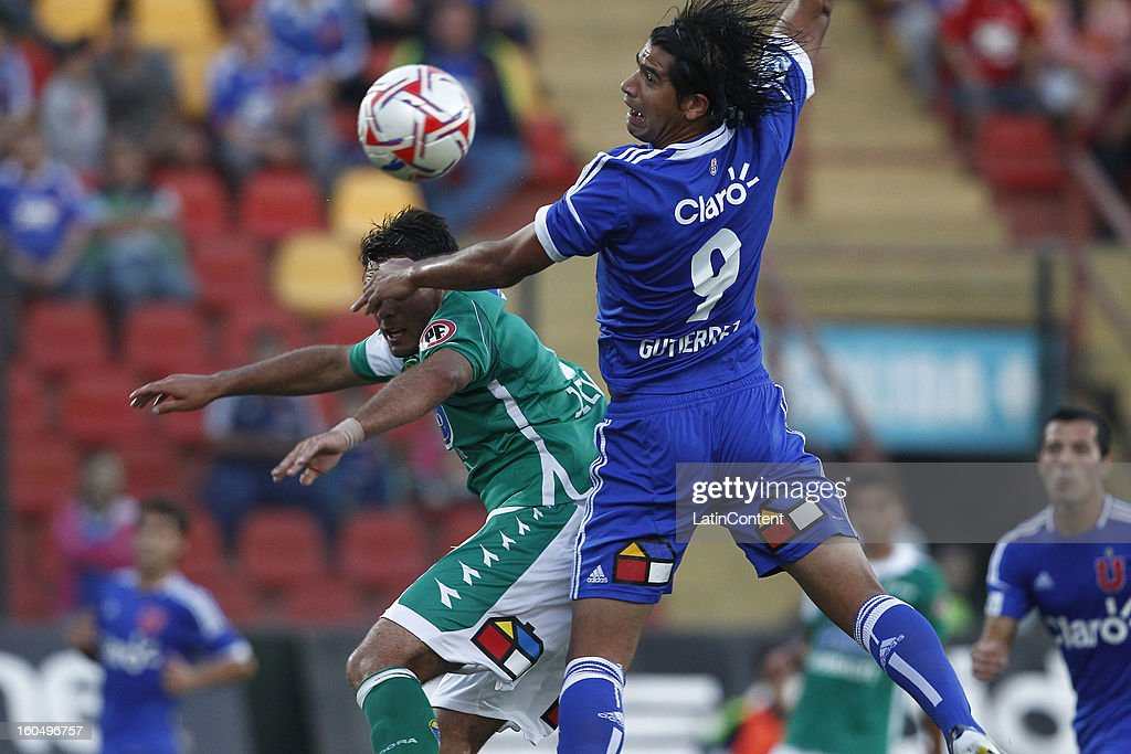 Enzo Gutierrez of Universidad de Chile fights for the ball with Cristian Oviedo of Audax Italiano during a match between Universidad de Chile and Audax Italiano as part of the Torneo Transición 2013 at Santa Laura Stadium on February 01, 2013 in Santiago, Chile.