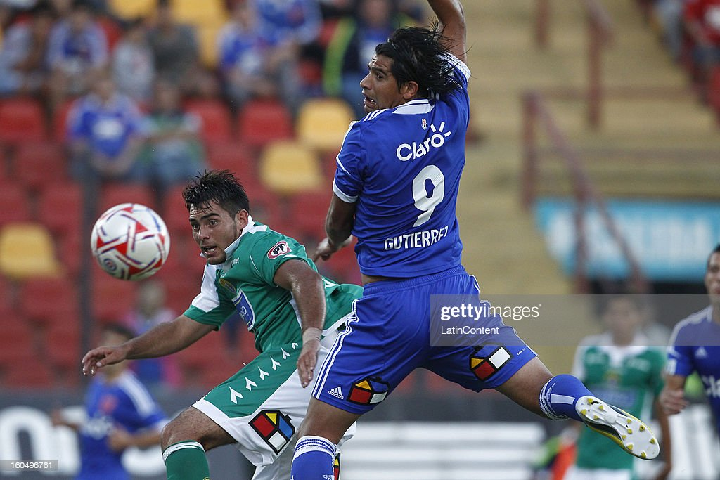 Enzo Gutierrez of Universidad de Chile fights for the ball with Fracisco Gaete of Audax Italiano during a match between Universidad de Chile and Audax Italiano as part of the Torneo Transición 2013 at Santa Laura Stadium on February 01, 2013 in Santiago, Chile.
