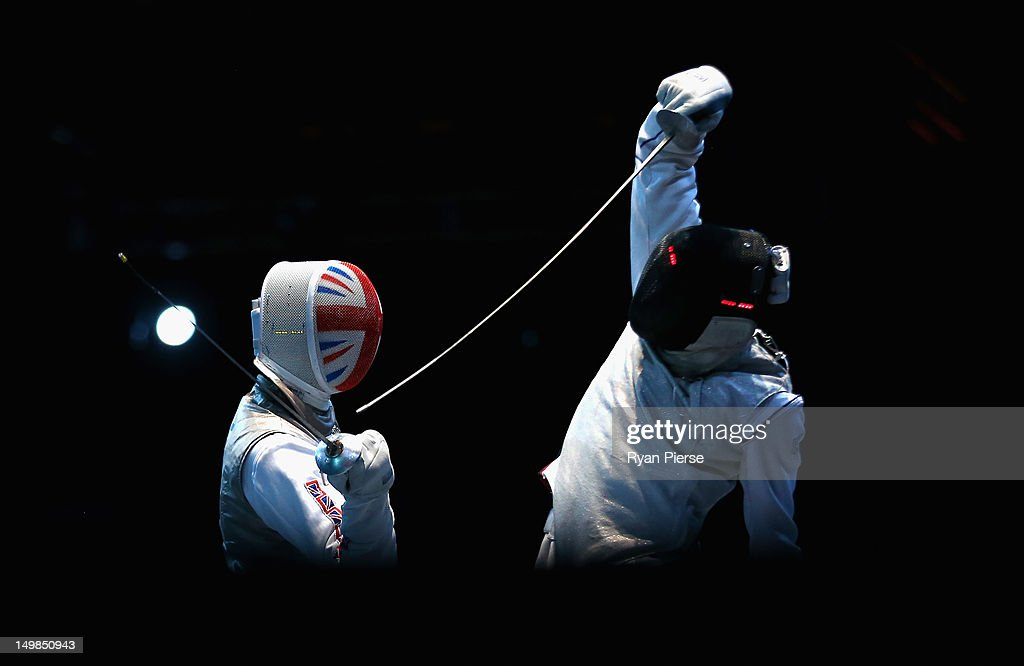 Enzo Lefort of France strkes Richard Kruse of Great Britain during the Men's Foil Team Fencing Classification 58 on Day 9 of the London 2012 Olympic...