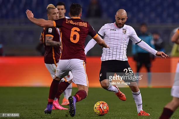 Enzo Maresca of Palermo is challenged by Kevin Strootman of Roma during the Serie A match between AS Roma and US Citta di Palermo at Stadio Olimpico...